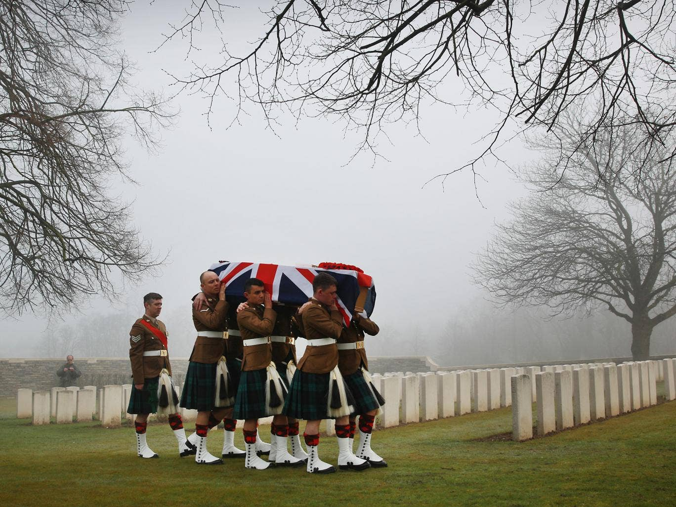 Soldiers of The 2nd Battalion The Royal Regiment of Scotland carry the coffin of Private William McAleer, from the 7th Battalion the Royal Scottish Fusiliers during a re-burial ceremony Loos British Cemetery in Loos-en-Gohelle, France. Almost 100 years af