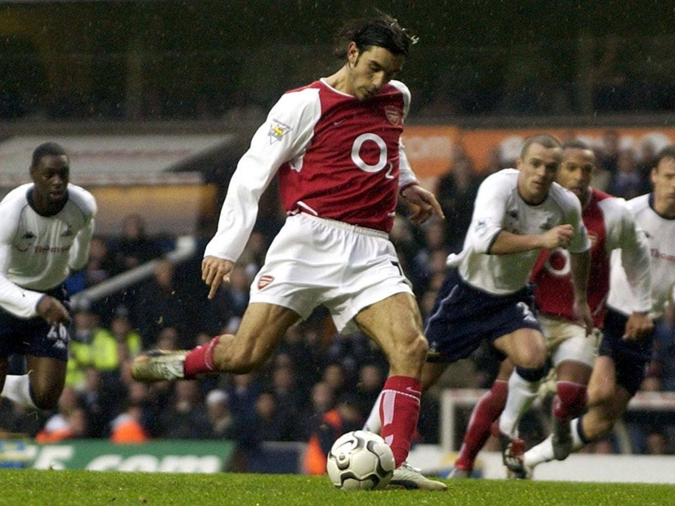 Robert Pires scores from the penalty spot against Tottenham in December 2002