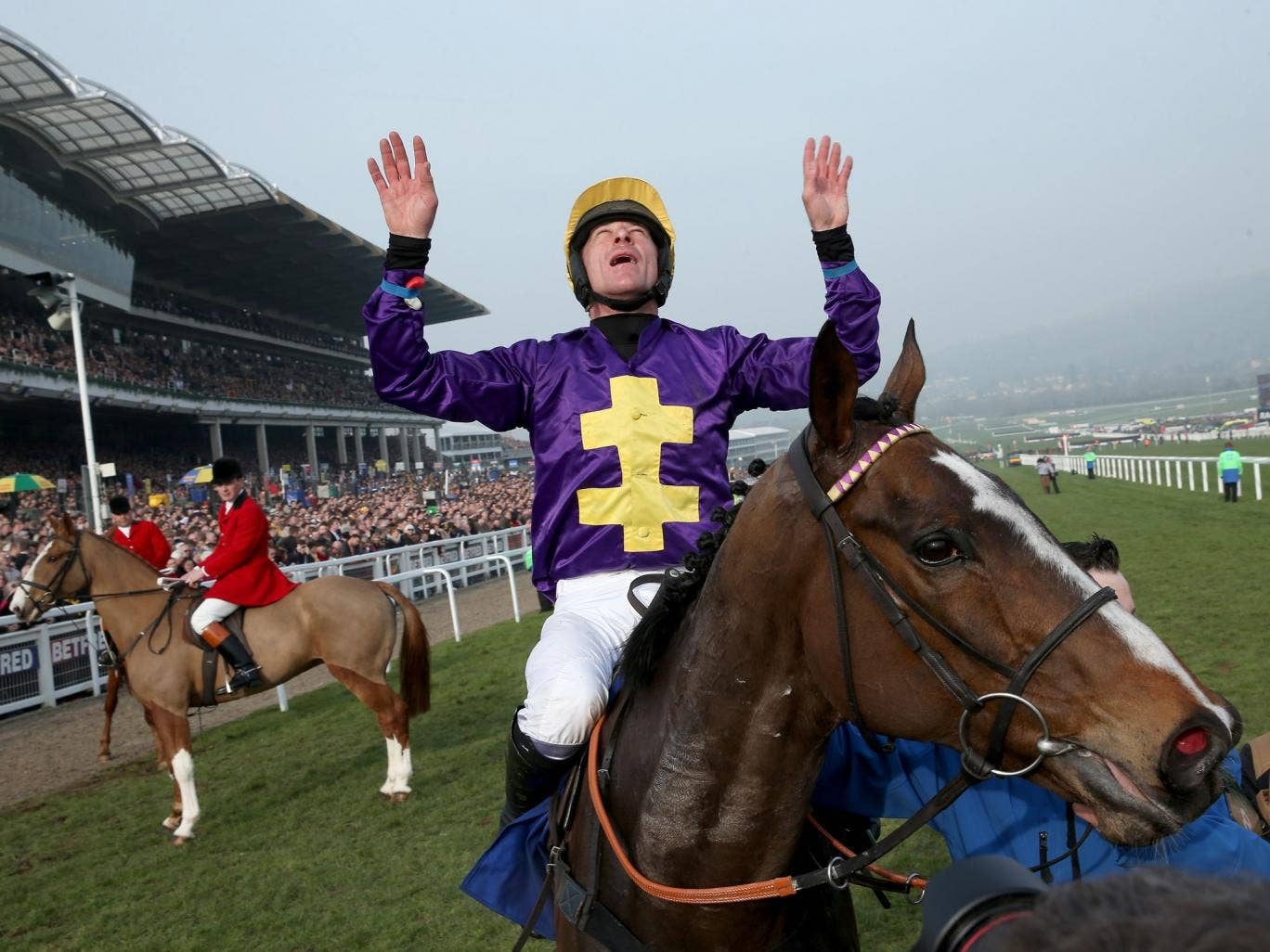 Davy Russell celebrates after riding Lord Windermere to victory in the Betfred Cheltenham Gold Cup Chase on Gold Cup day at the Cheltenham Festival