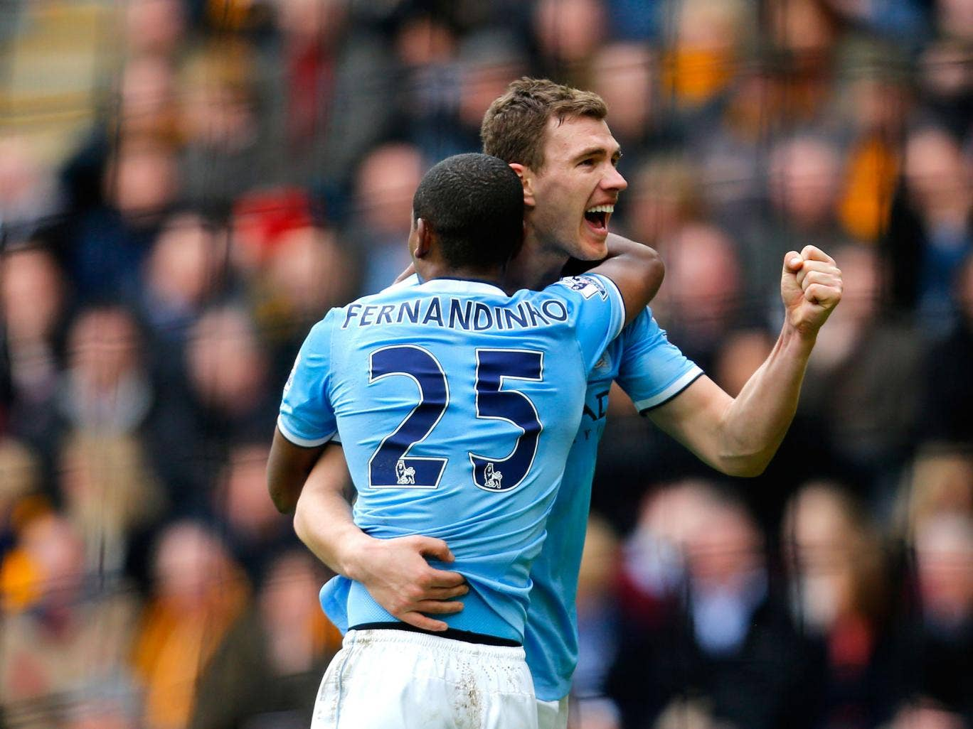Edin Dzeko of Manchester City celerates with teammate Fernandinho