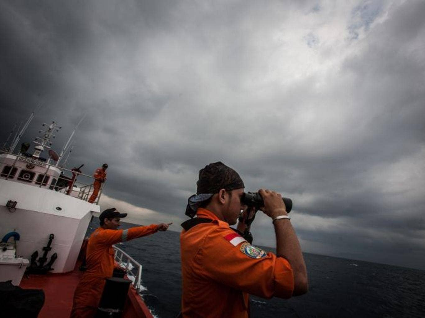 Indonesian search and rescue workers survey high seas as part of the search mission