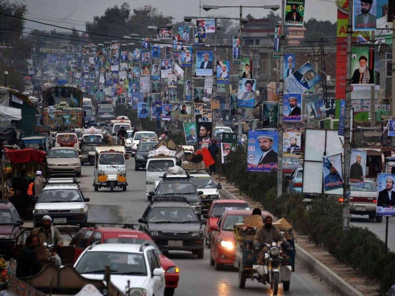 Poster power: Candidates' faces line a road in Jalalabad yesterday