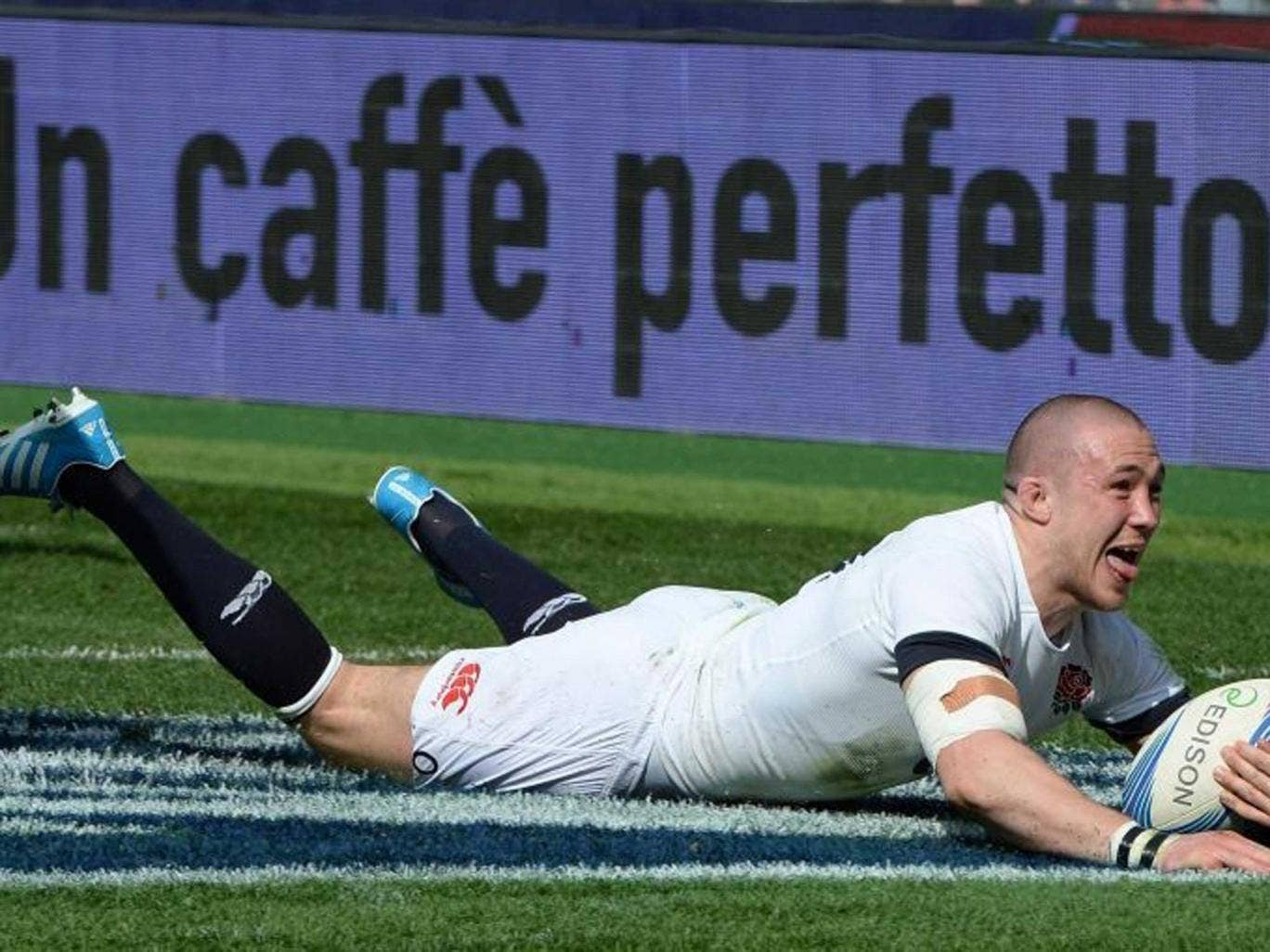 Golden Brown: The England full-back goes over for the second of his two tries against Italy in Rome yesterday