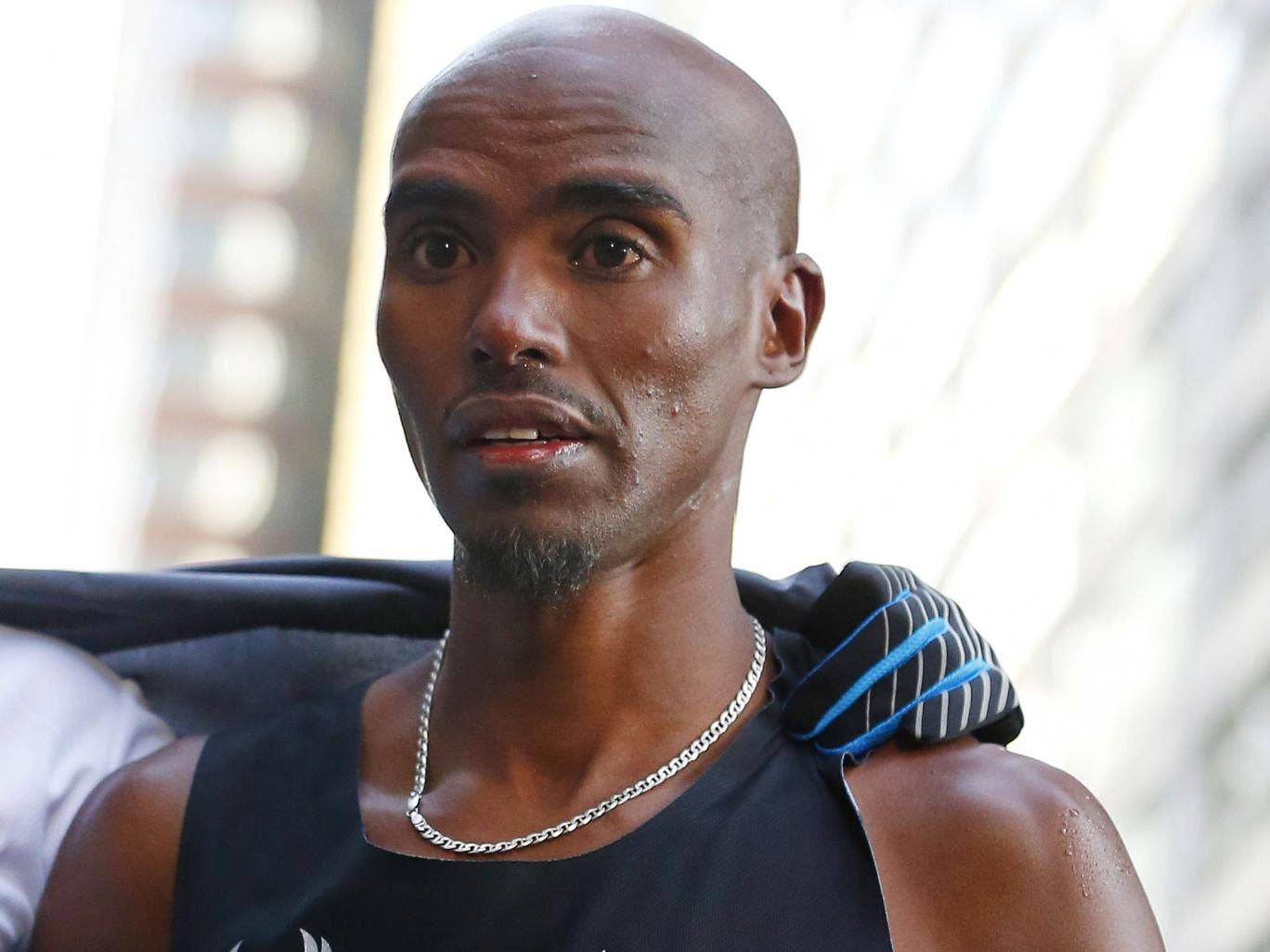 Mo Farah pictured shortly before collapsing at the finish line in New York on Sunday. He recovered to attend the press conference afterwards