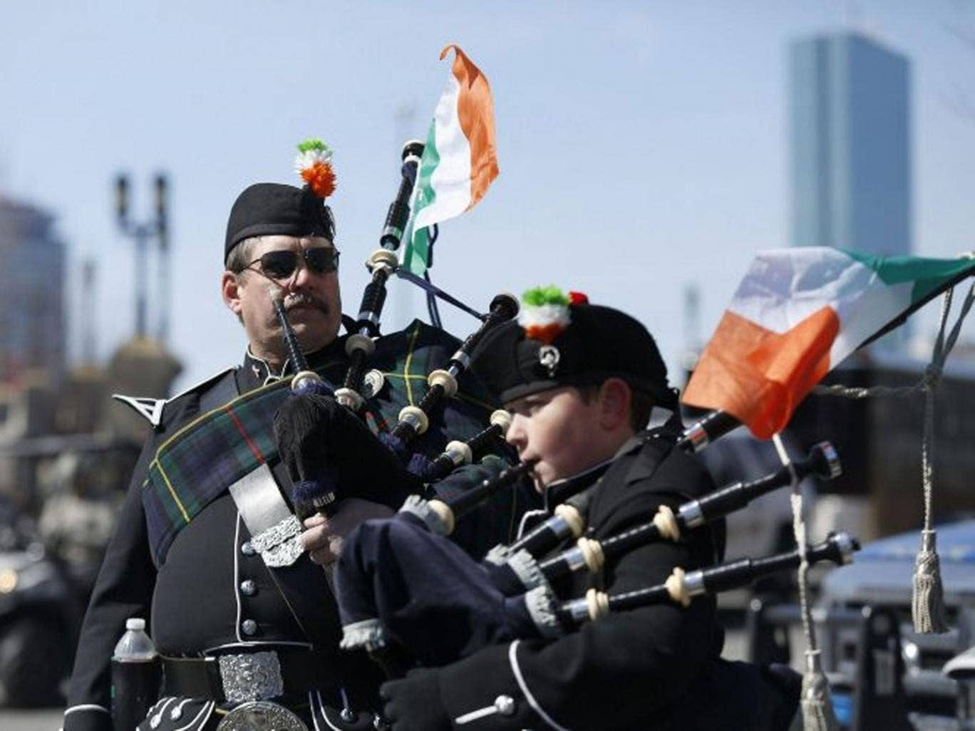 Members of the Quaboag Highlanders Pipes and Drums prepare to march down Broadway during the annual South Boston St. Patrick's Day parade in Boston, Massachusetts March 16, 2014. Boston's Irish-American mayor skipped the parade on Sunday after failing to