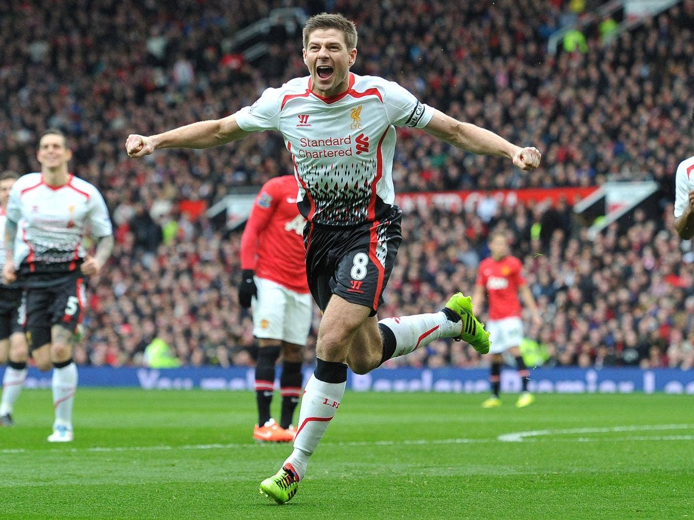 Steven Gerrard celebrates scoring his second penalty in the 3-0 win over Manchester United