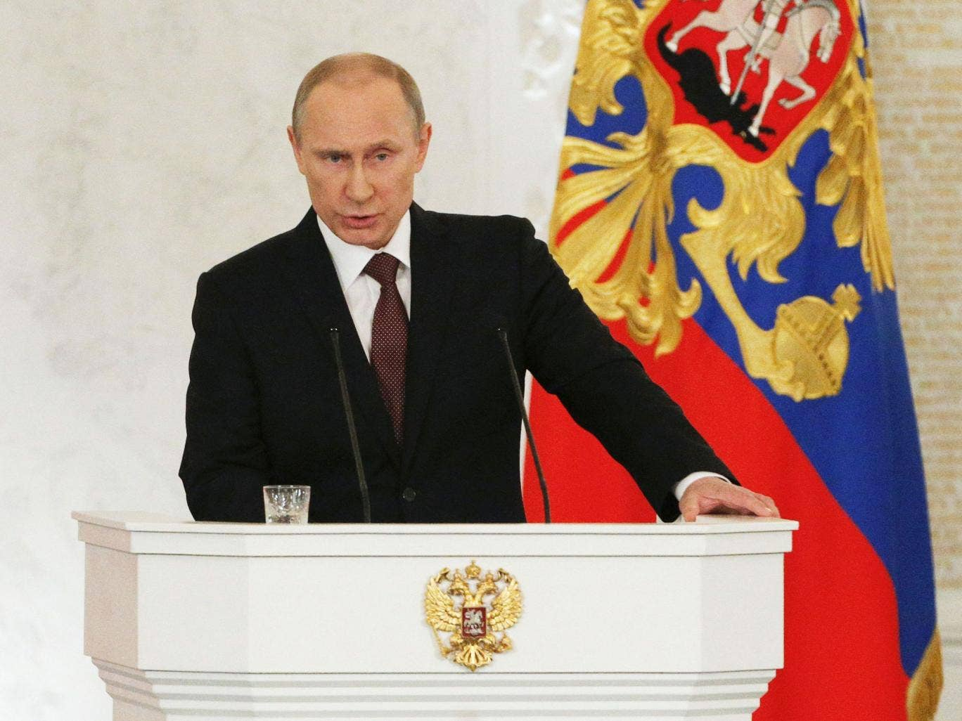 Russian President Vladimir Putin addresses the Federal Assembly, including State Duma deputies, members of the Federation Council, regional governors and civil society representatives, at the Kremlin in Moscow March 18, 2014