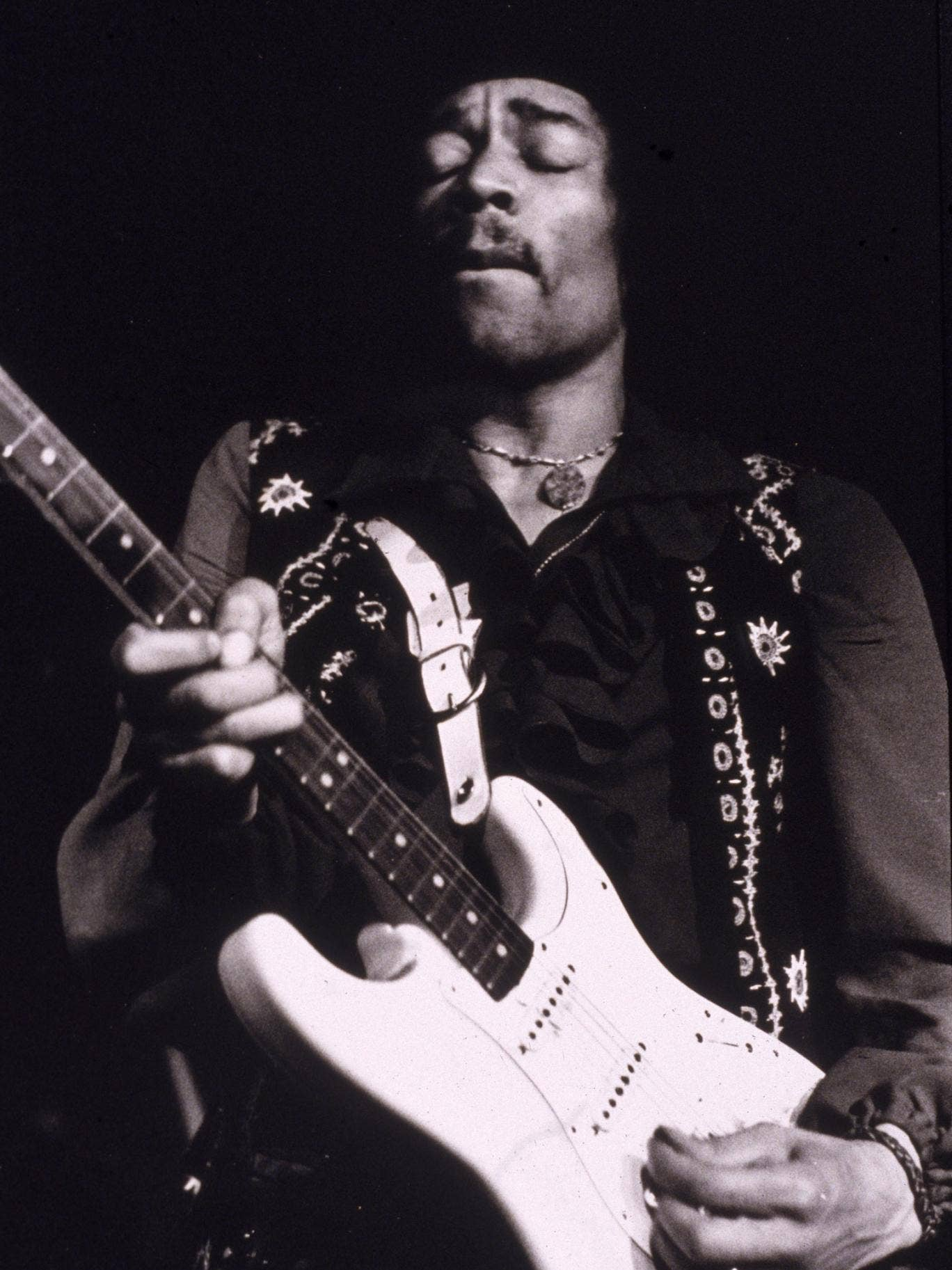 American musician Jimi Hendrix performs onstage, late 1960s.