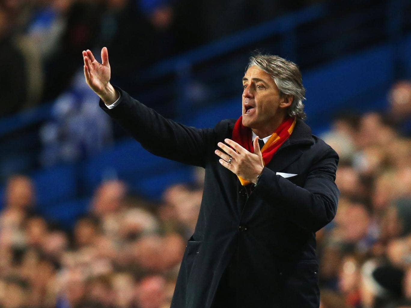 Roberto Mancini makes a gesture from the touchline at Stamford Bridge