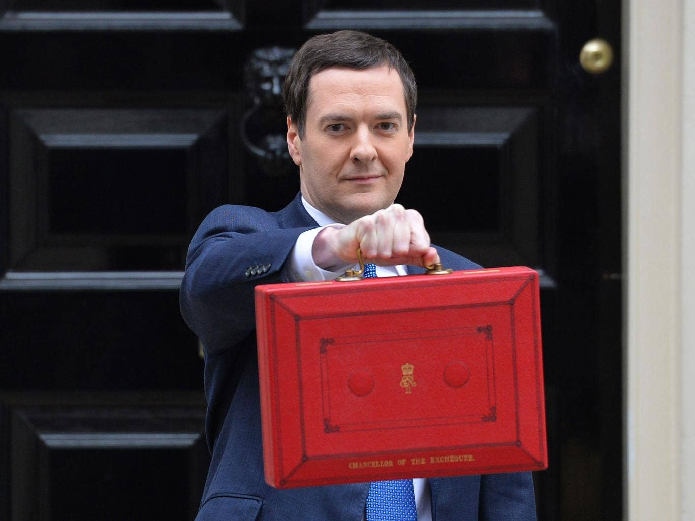 British Chancellor of the Exchequer George Osborne holds the budget box outside 11 Downing Street in London