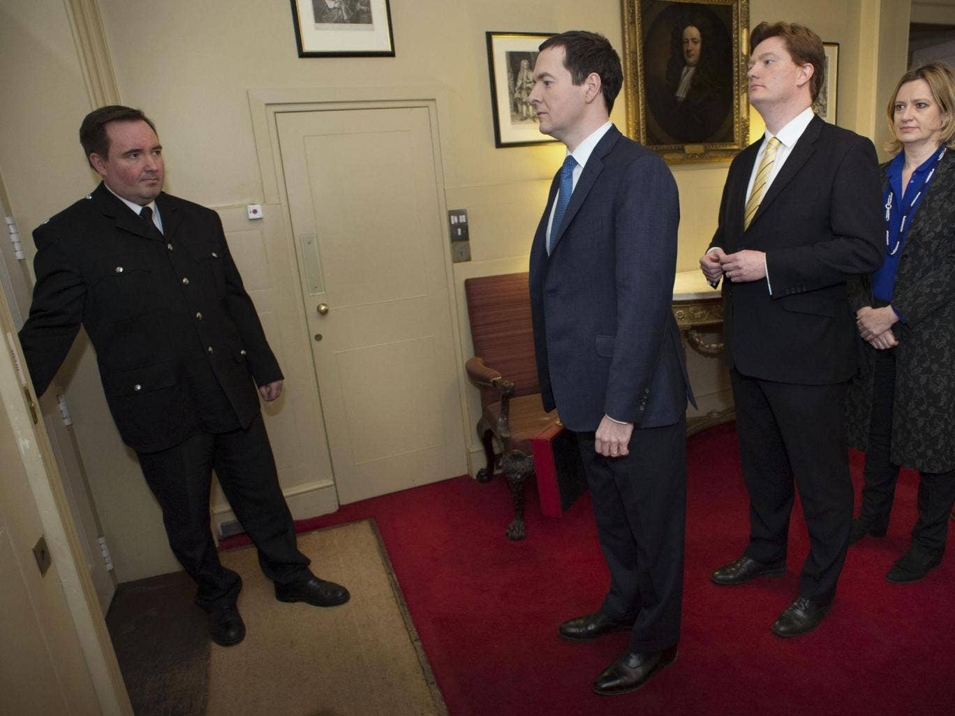 Britain's Chancellor of the Exchequer George Osborne leads his Treasury team as they prepare to leave number 11 Downing Street to pose for photographers before going to the House of Commons to present the Budget
