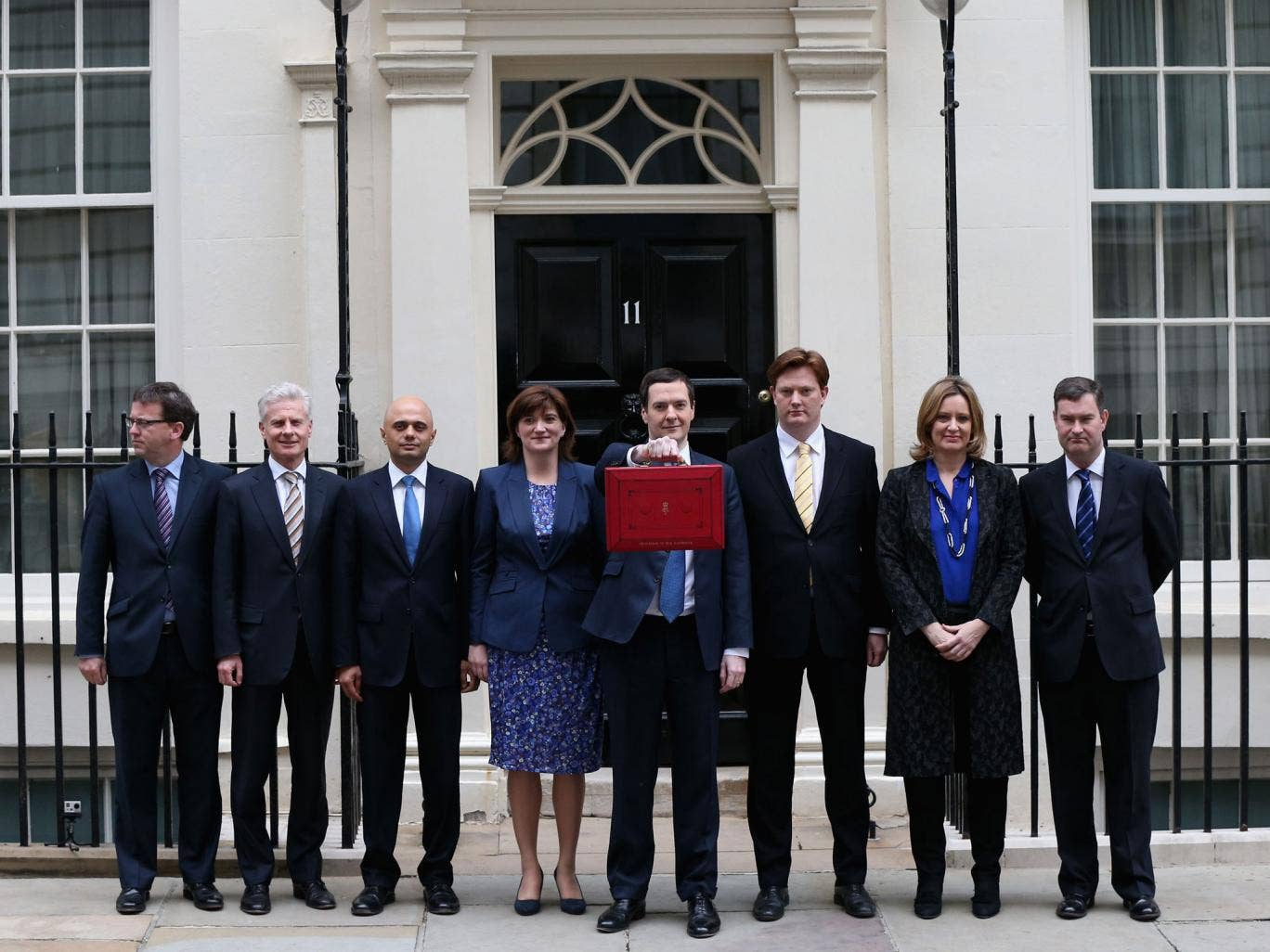 The Chancellor of the Exchequer George Osborne holding the budget box stands with his Treasury team (2nd L-R) Commercial Secretary to the Treasury Lord Deighton, Financial Secretary to the Treasury Sajid Javid, Economic Secretary to the Treasury Nicky Mor