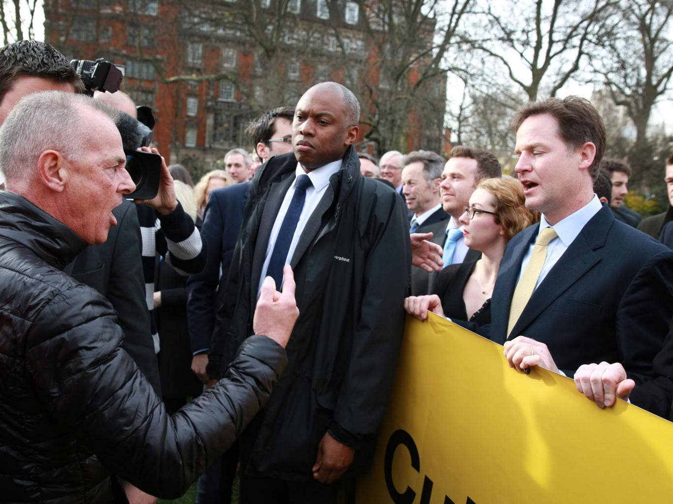 Protestor Bill Maloney (L) gestures as he shouts at Deputy Prime Minister Nick Clegg (R) who abandoned a photocall near Parliament to promote a tax cut announced in the budget on March 19, 2014 in London, England. The Chancellor of the Exchequer, George O