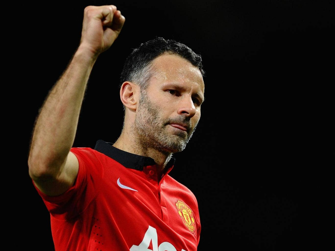 Ryan Giggs celebrates after Manchester United's 3-0 victory over Olympiakos