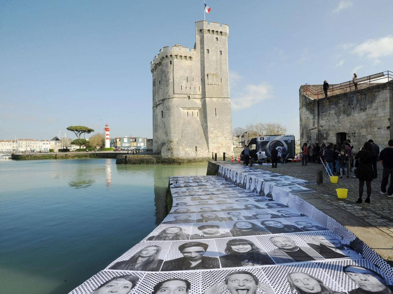 The portraits are also displayed on a harbour's embankment