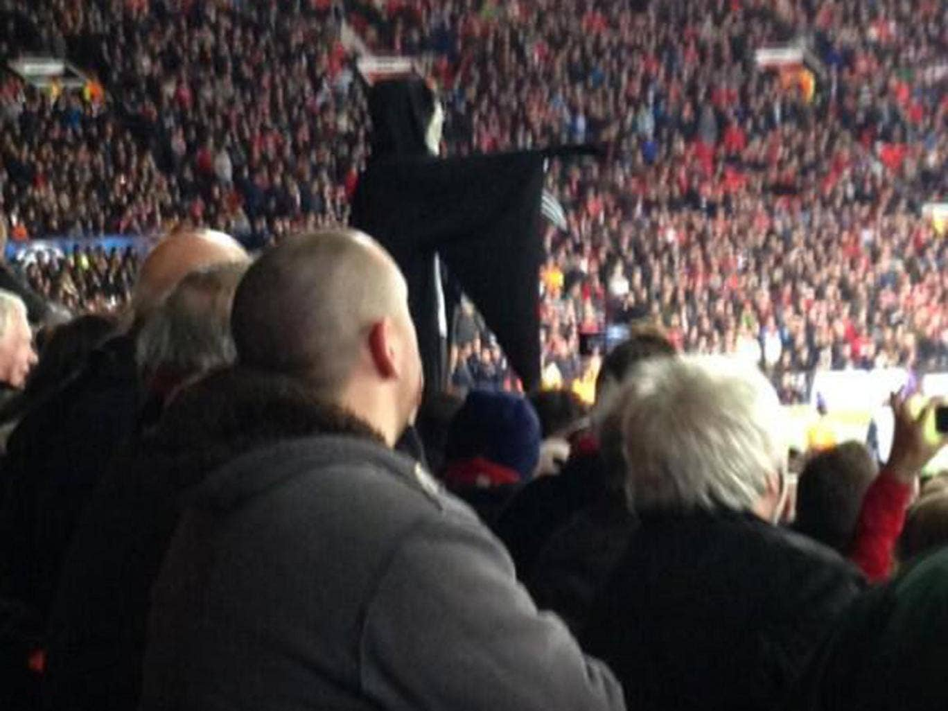 "A fan dressed up as the Grim Reaper during Manchester United's win over Olympiakos, shouting at David Moyes ""Moyes, I'm coming to get you!"""