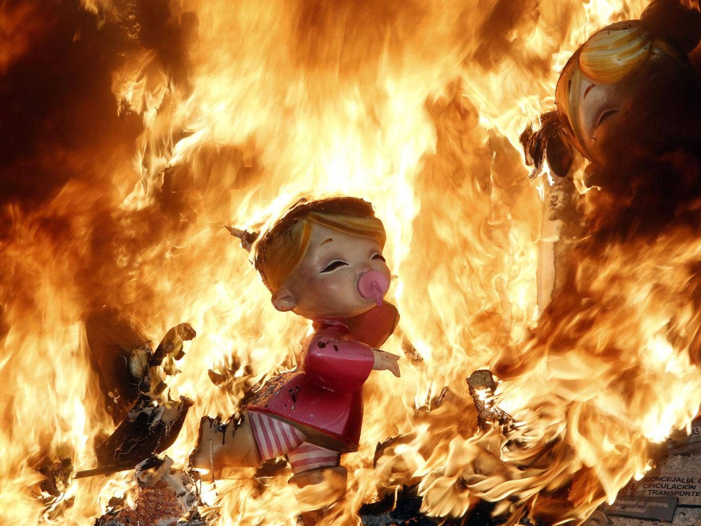 Satirical sculptures burn during the traditional Fallas festival in Valencia