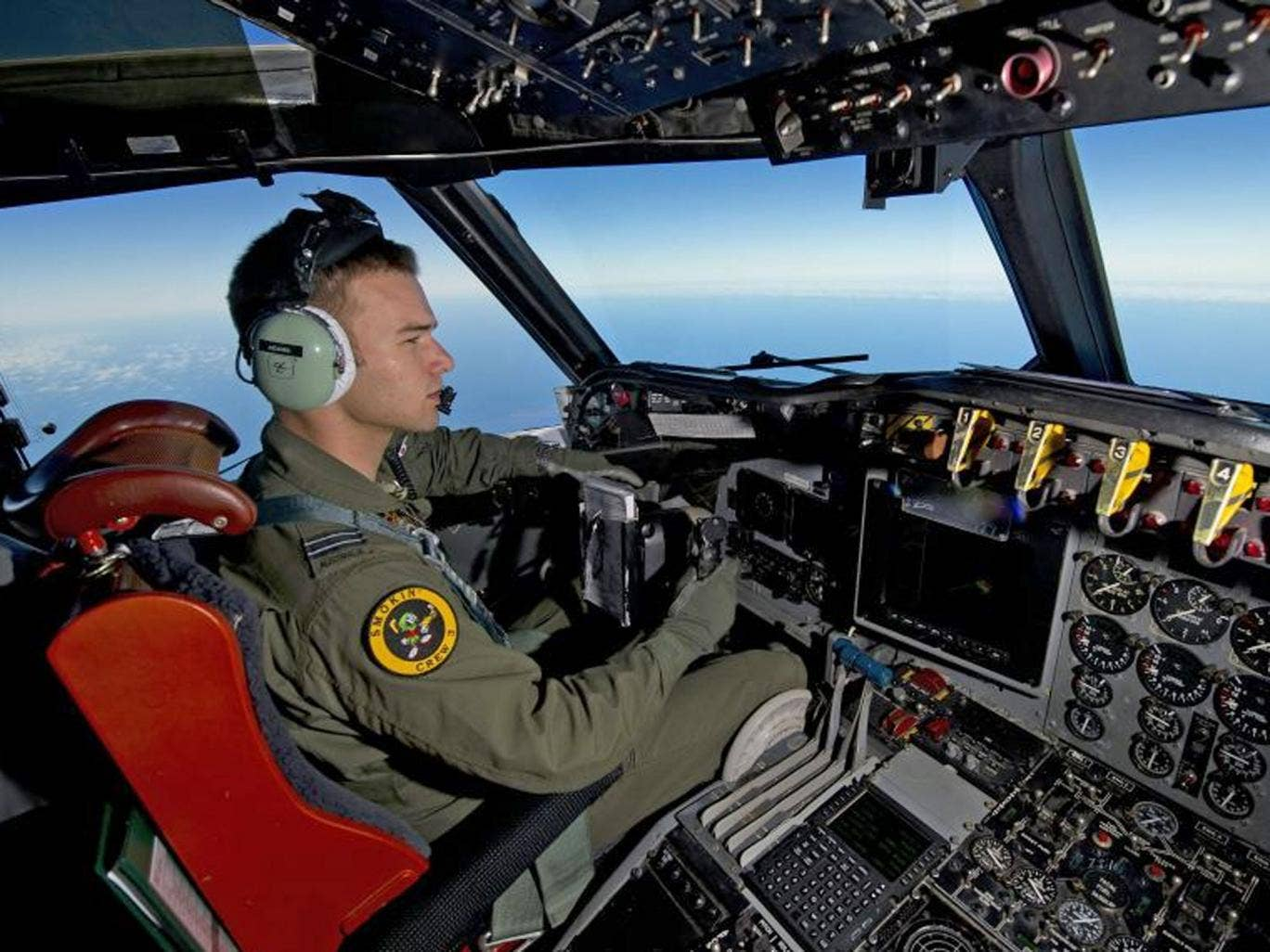 Royal Australian Air Force pilot, Flight Lieutenant Russell Adams from the tenth Squadron, steering his AP-3C Orion over the Southern Indian Ocean during the search for missing Malaysian Airlines flight MH370