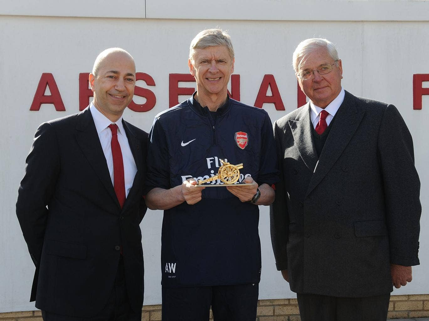 Chairman Sir Chips Keswick and CEO Ivan Gazidis present Arsene Wenger with a gold cannon to commemorate his 1000th game as Arsenal manager at London Colney