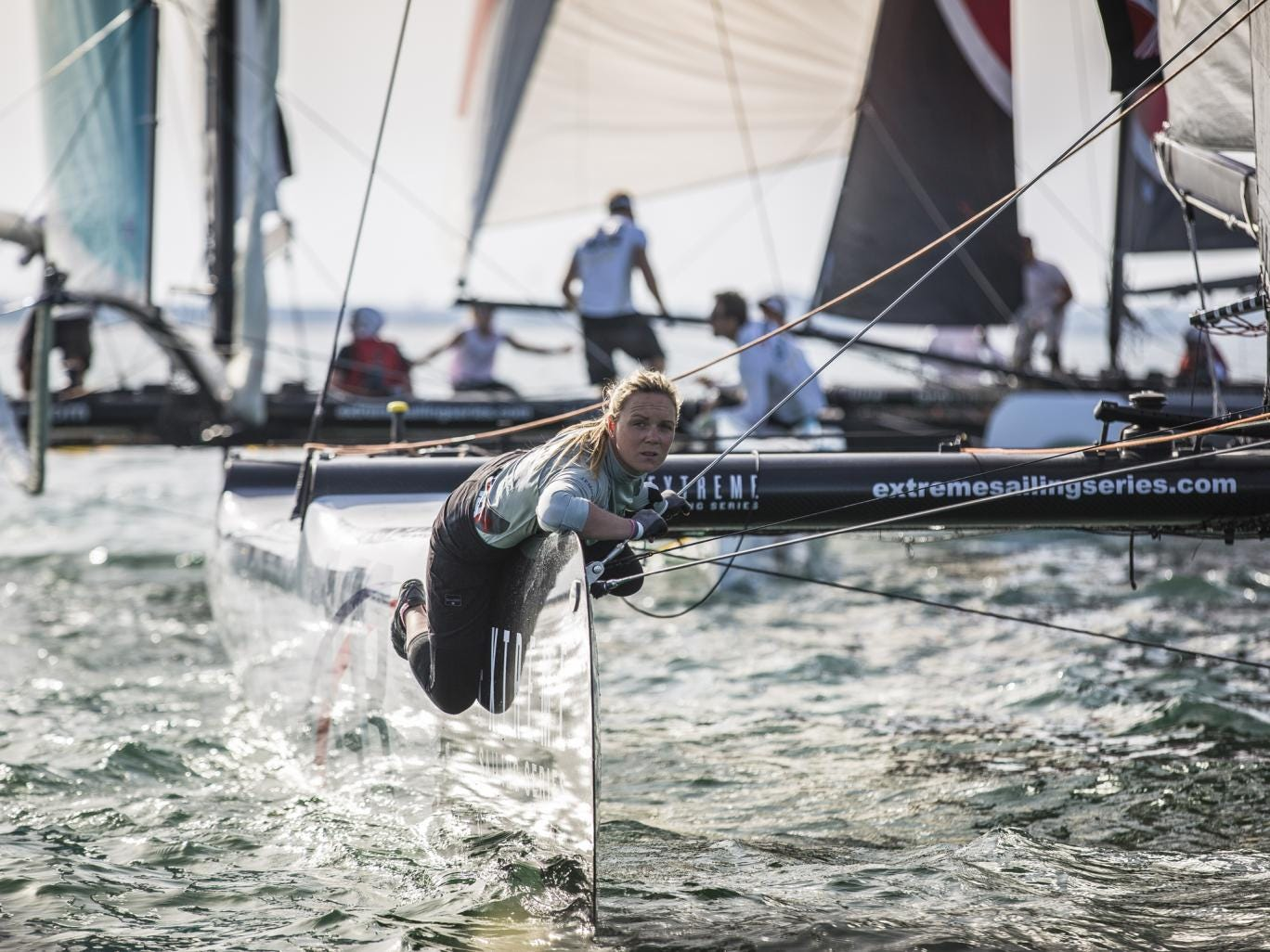 British gold medallist Pippa Wilson weighs up the race track from the bow of Sir Ben Ainslie's J.P.Morgan/BAR Extreme 40 on the second day of the Muscat regatta