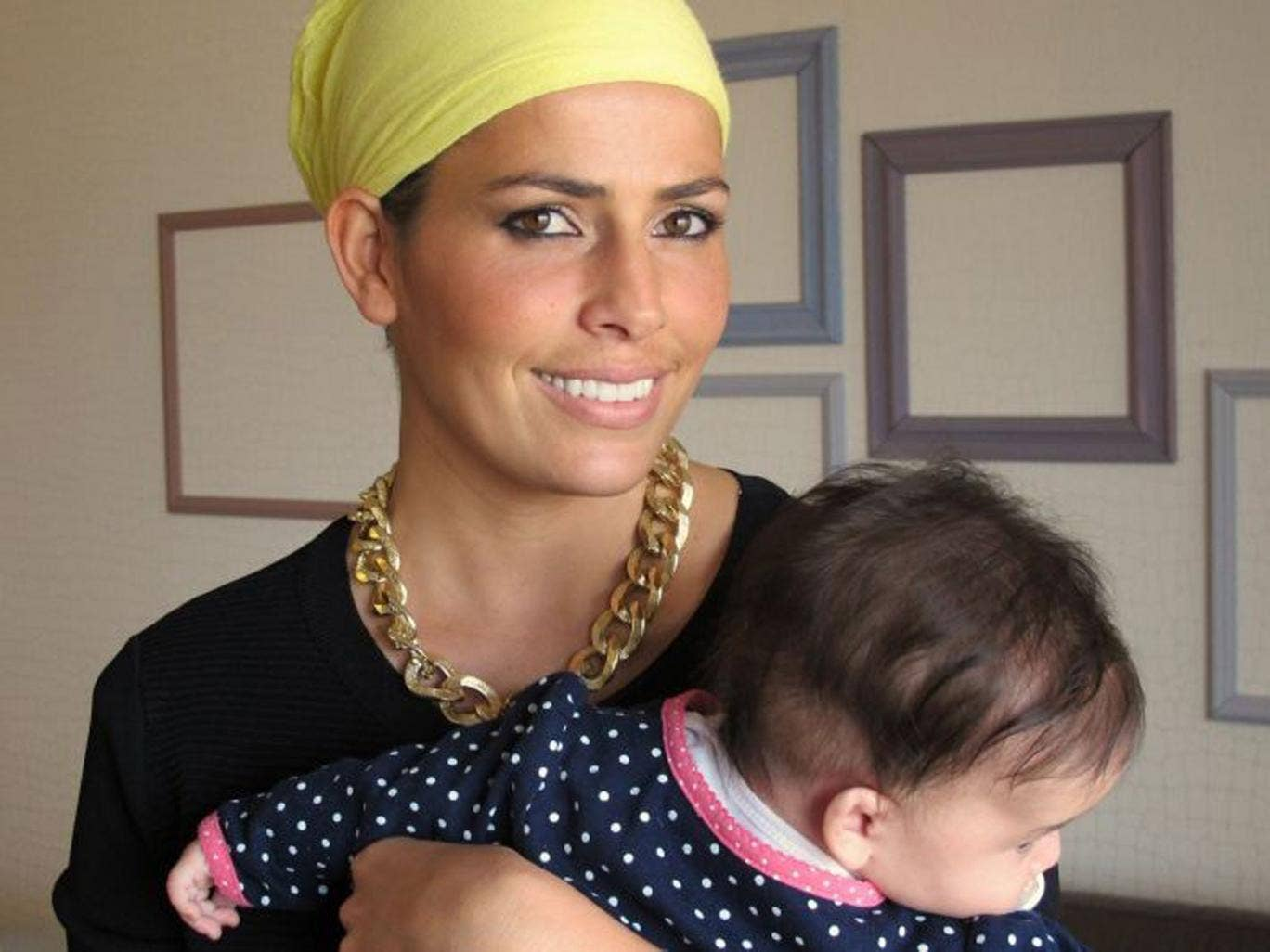 Ms Abargil with her four-month-old daughter at her home in Netanya, Israel