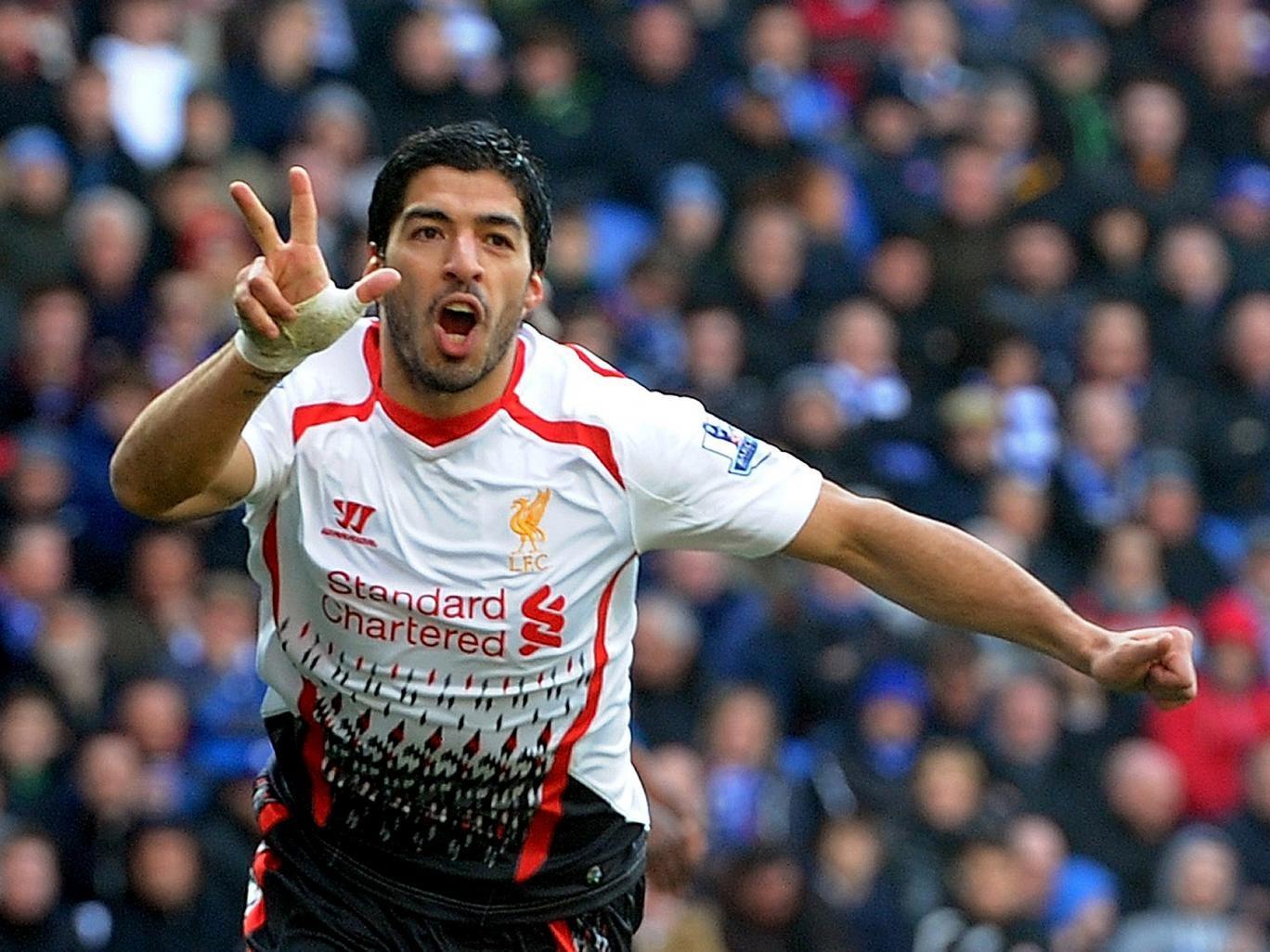 Luis Suarez celebrates his hat-trick for Liverpool against Cardiff