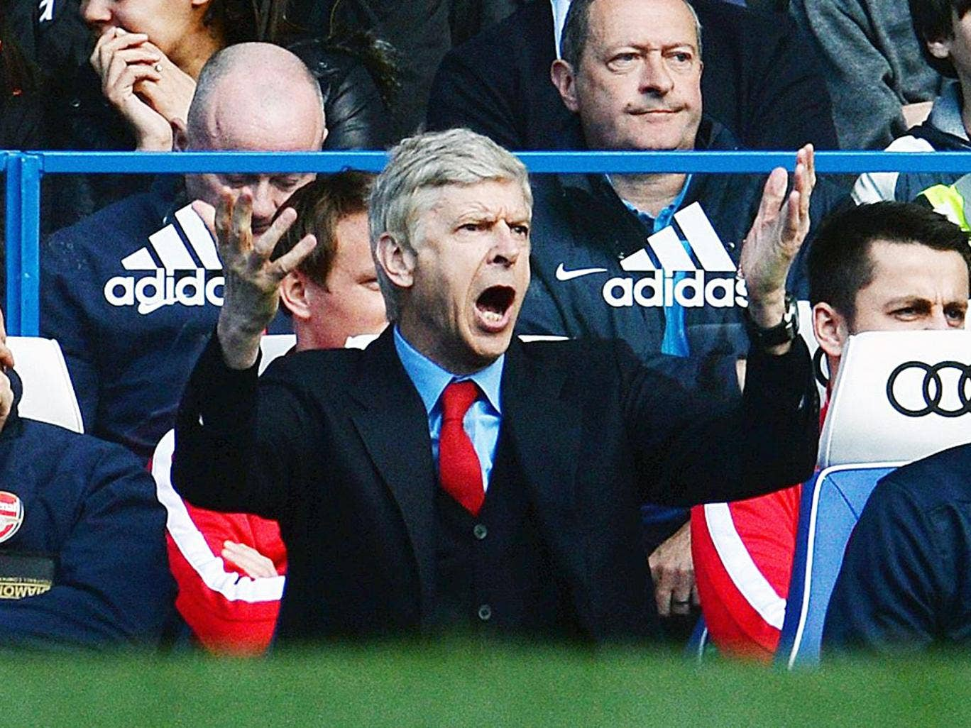 Arsene Wenger gestures from the dugout at Stamford Bridge during Arsenal's 6-0 defeat to Chelsea