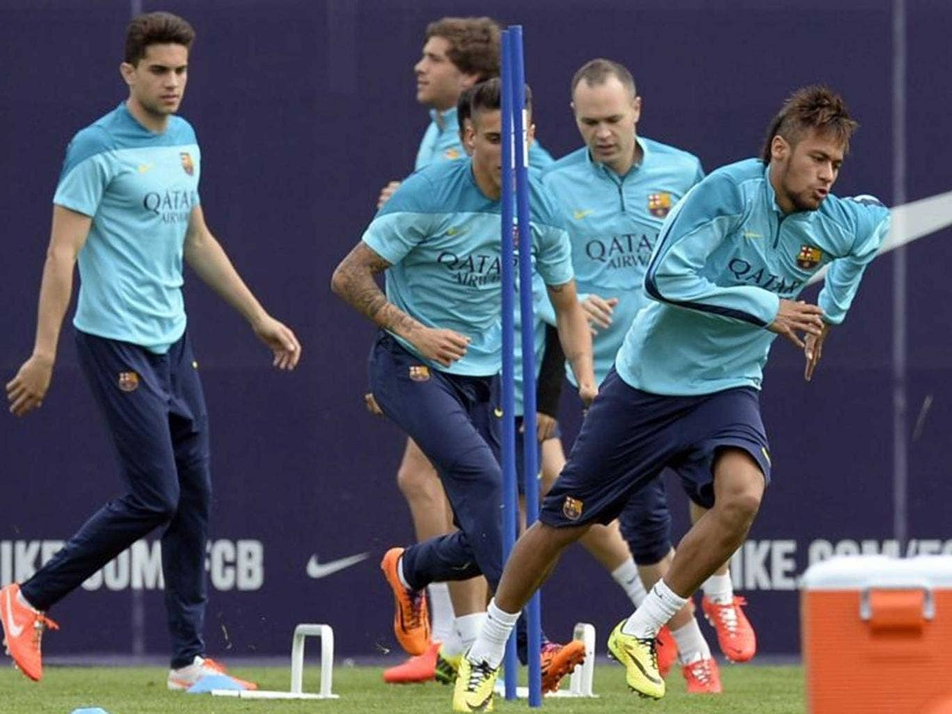 Training camp: Neymar (right) exercises with Barcelona team-mates ahead of today's Clasico against Real Madrid