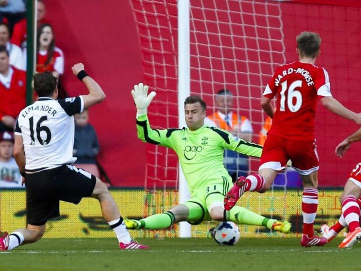 Norwich City's Johan Elmander scores past Southampton's Artur Boruc during the Barclays Premier League match