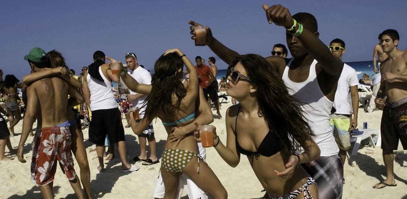 Spring breakers on the beach in Cancun, Mexico, one of the most popular destinations for the traditional students' rite of passage