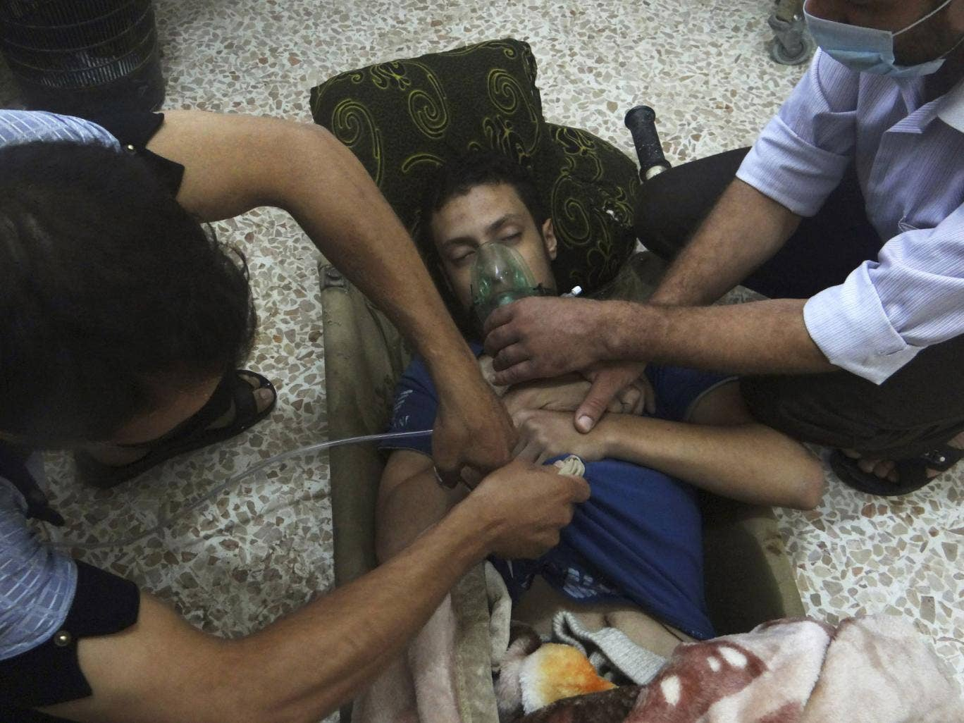 A man, reportedly injured by nerve gas, receives oxygen in the Damascus suburb of Jesreen. The UN says March will be seen as the critical month for destroying chemical weapons
