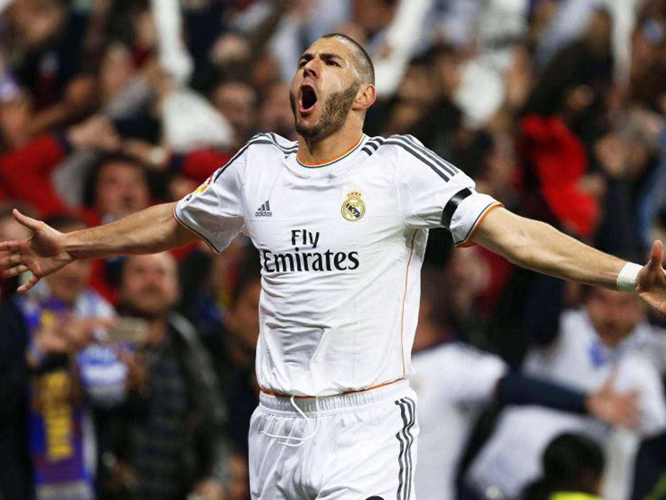 Karim Benzema celebrates his first goal of the game for Real Madrid