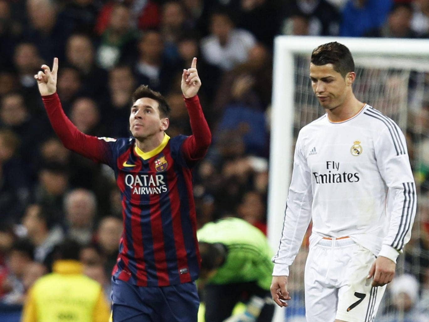 Lionel Messi,left, celebrates scoring the second of his three goals that helped Barcelona to a 4-3 victory over Cristiano Ronaldo's Real Madrid at the Bernabeu