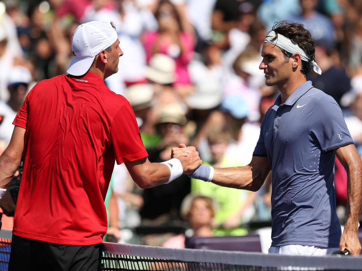 Roger Federer shakes hands with Thiemo de Bakker after beating him 6-3 6-3 in Miami