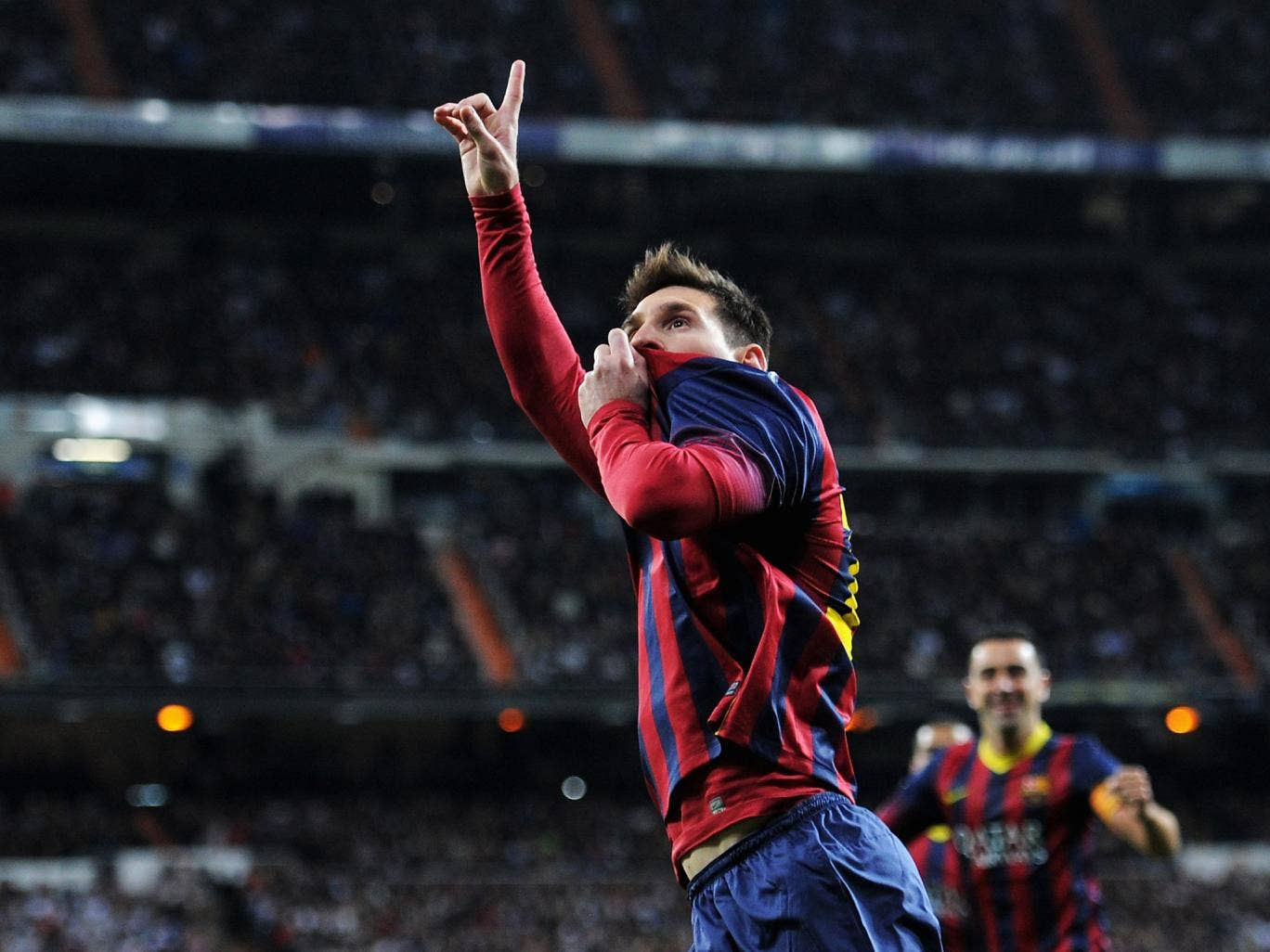 Lionel Messi celebrates after scoring at the Bernabeu