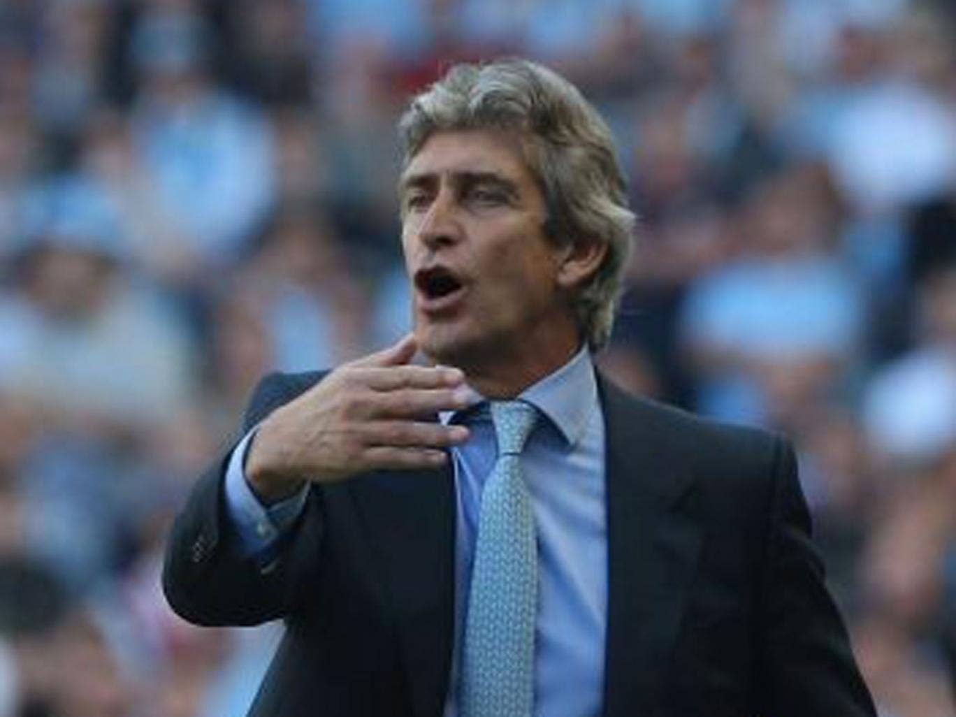 Manuel Pellegrini watches from the touchline during the Barclays Premier League match between Manchester City and Manchester United