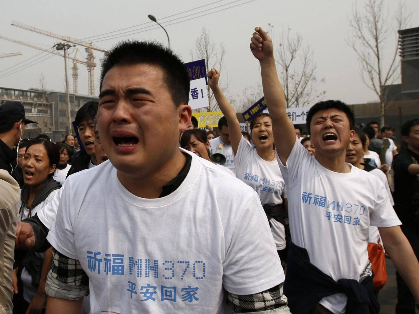 "Dozens of angry relatives of passengers on the lost Malaysian jetliner clashed with police in Beijing on Tuesday, accusing the Southeast Asian country of ""delays and deception"""