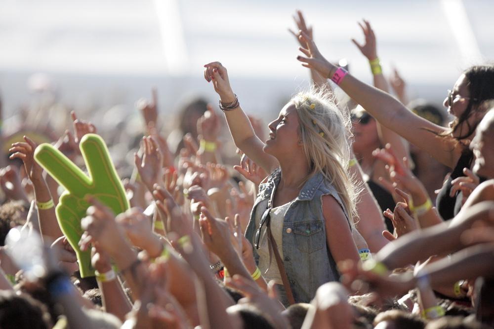 Festival fans enjoy the music in the sunshine