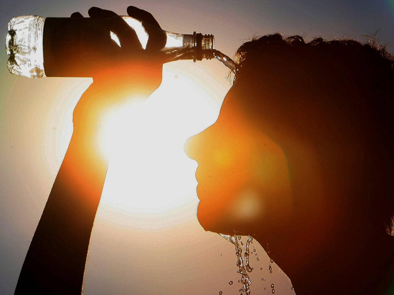 A man cools himself down. Hot summers are expected to become the norm by 2040