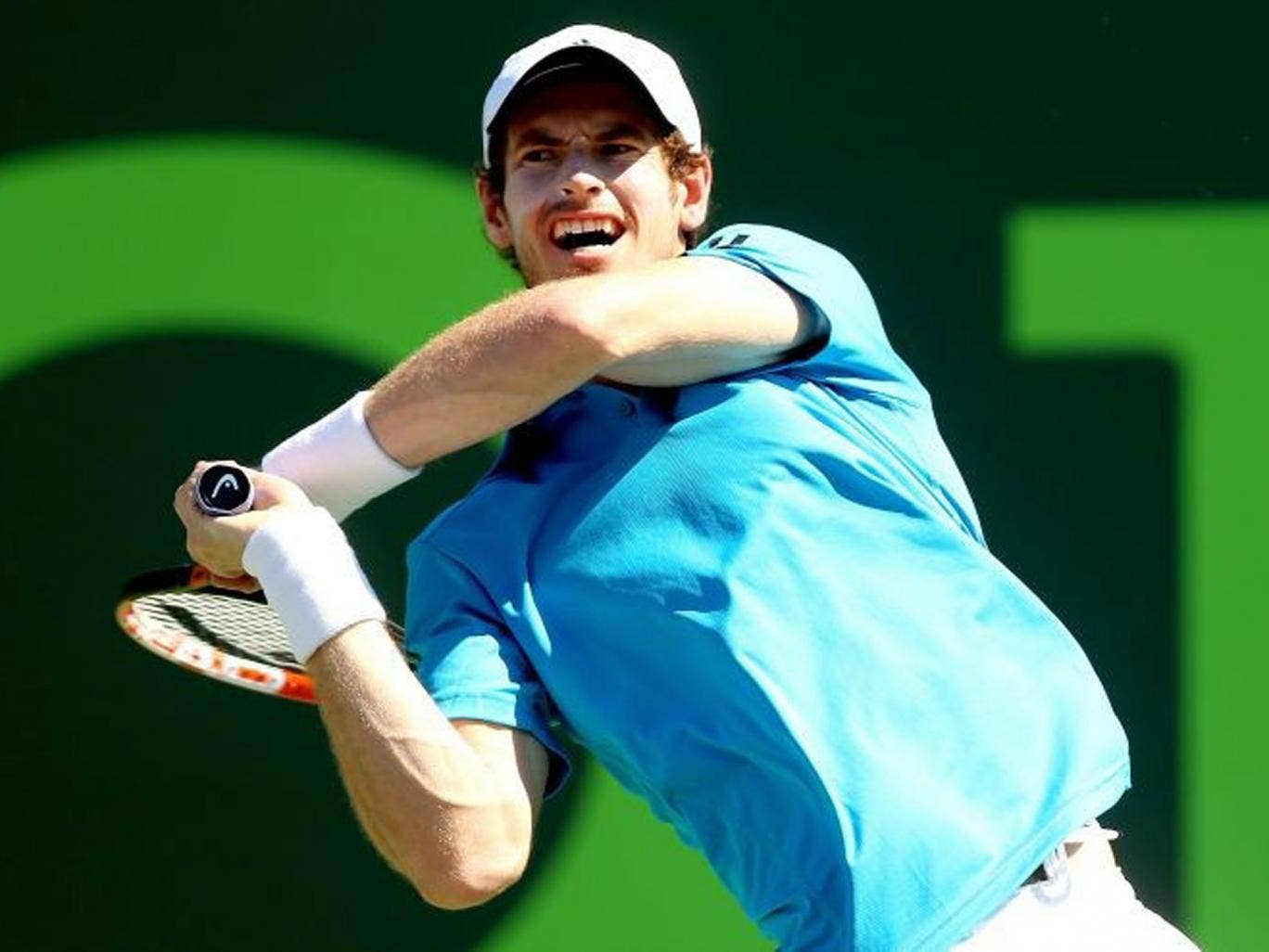 Andy Murray a shot to Jo-Wilfired Tsonga during the Sony Open at the Crandon Park Tennis Center on March 25, 2014 in Key Biscayne, Florida.