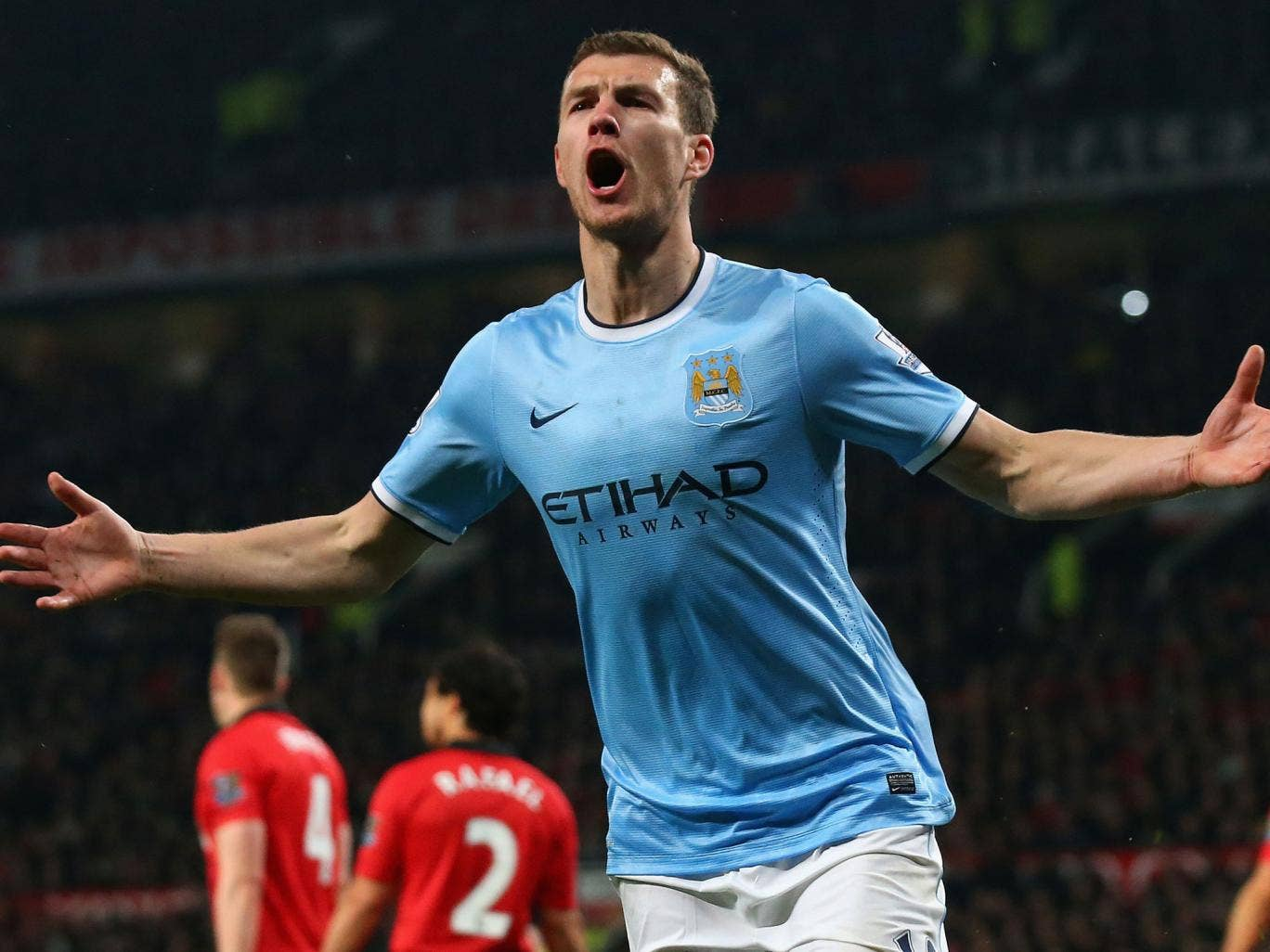 Edin Dzeko celebrates his second goal for Manchester City