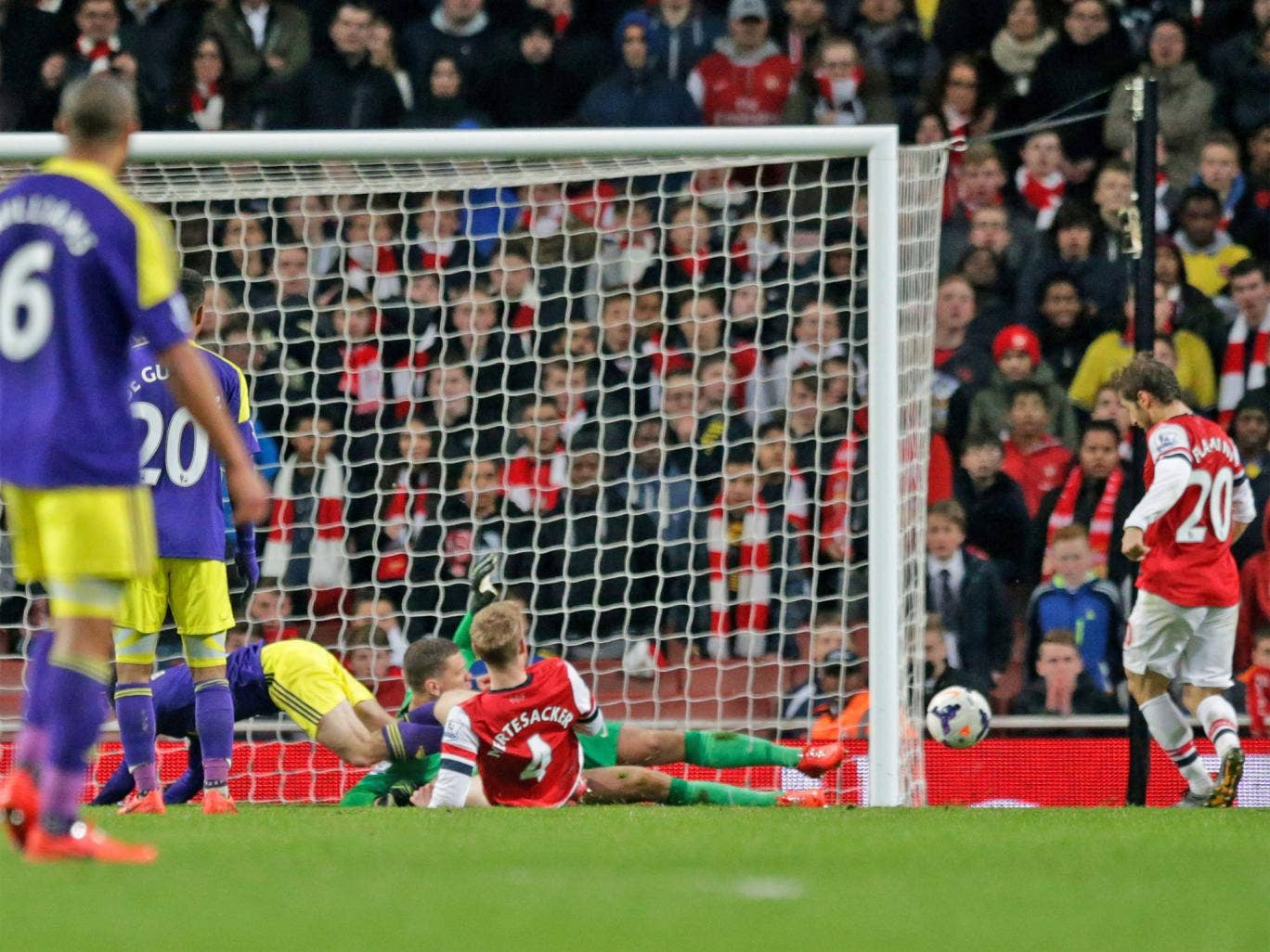 Mathieu Flamini scores a late own goal