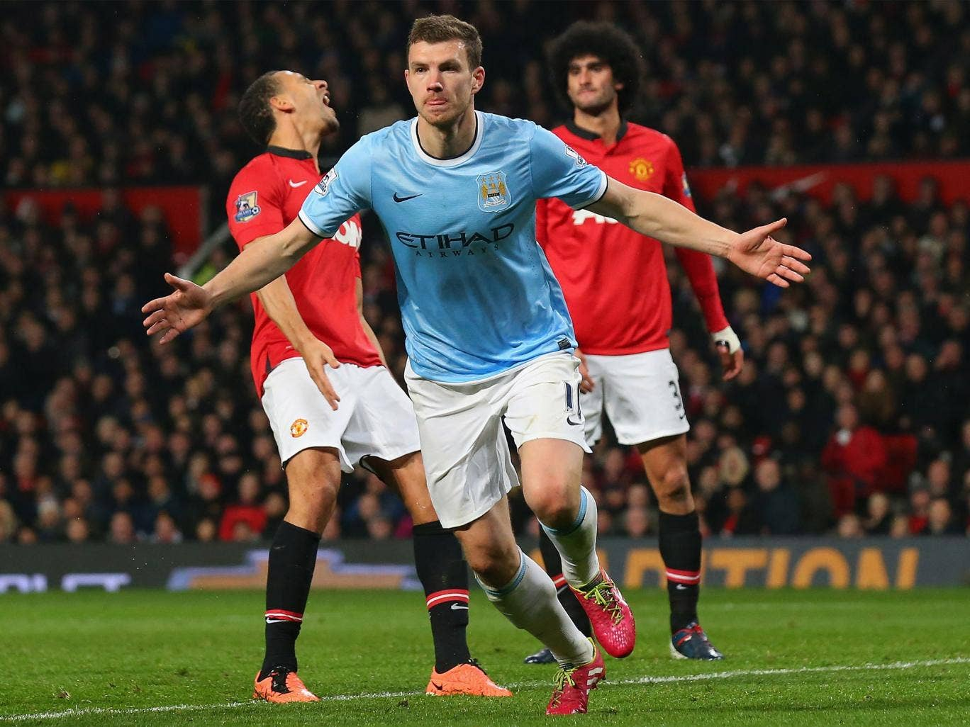 Edin Dzeko celebrates his second goal of the night