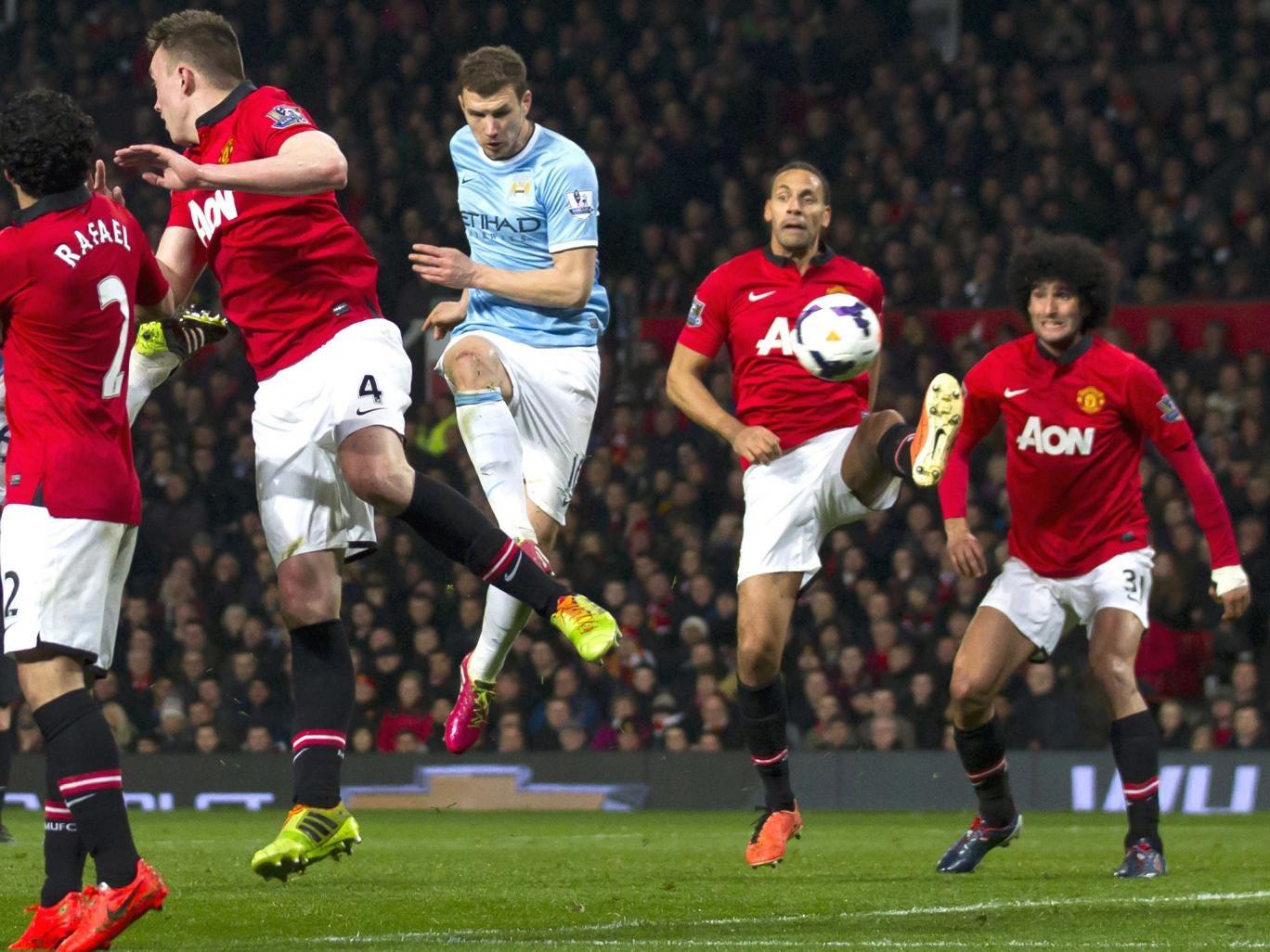 Edin Dzeko turns in his, and City's, second goal