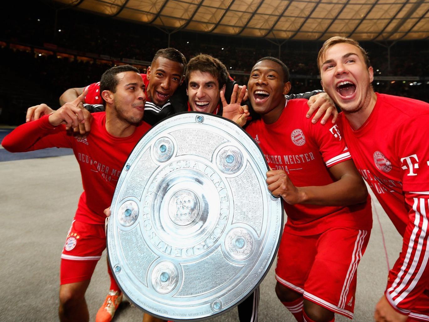 Thiago Alcantara, David Alaba, Javier Martínez Aguinaga and Mario Goetze of Bayern Muenchen celebrate winning the Bundesliga