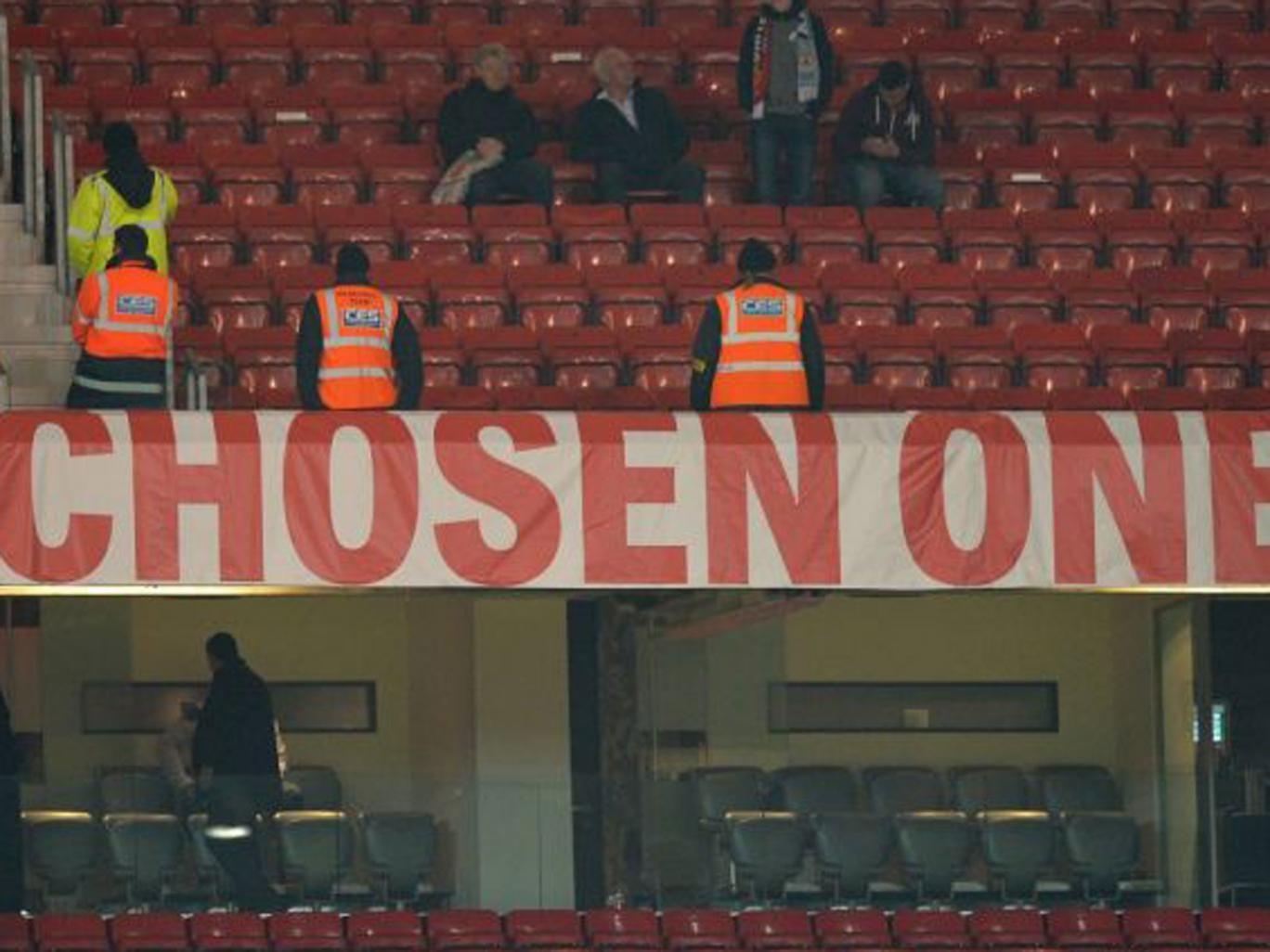 Stewards guard Moyes's banner at Old Trafford last night