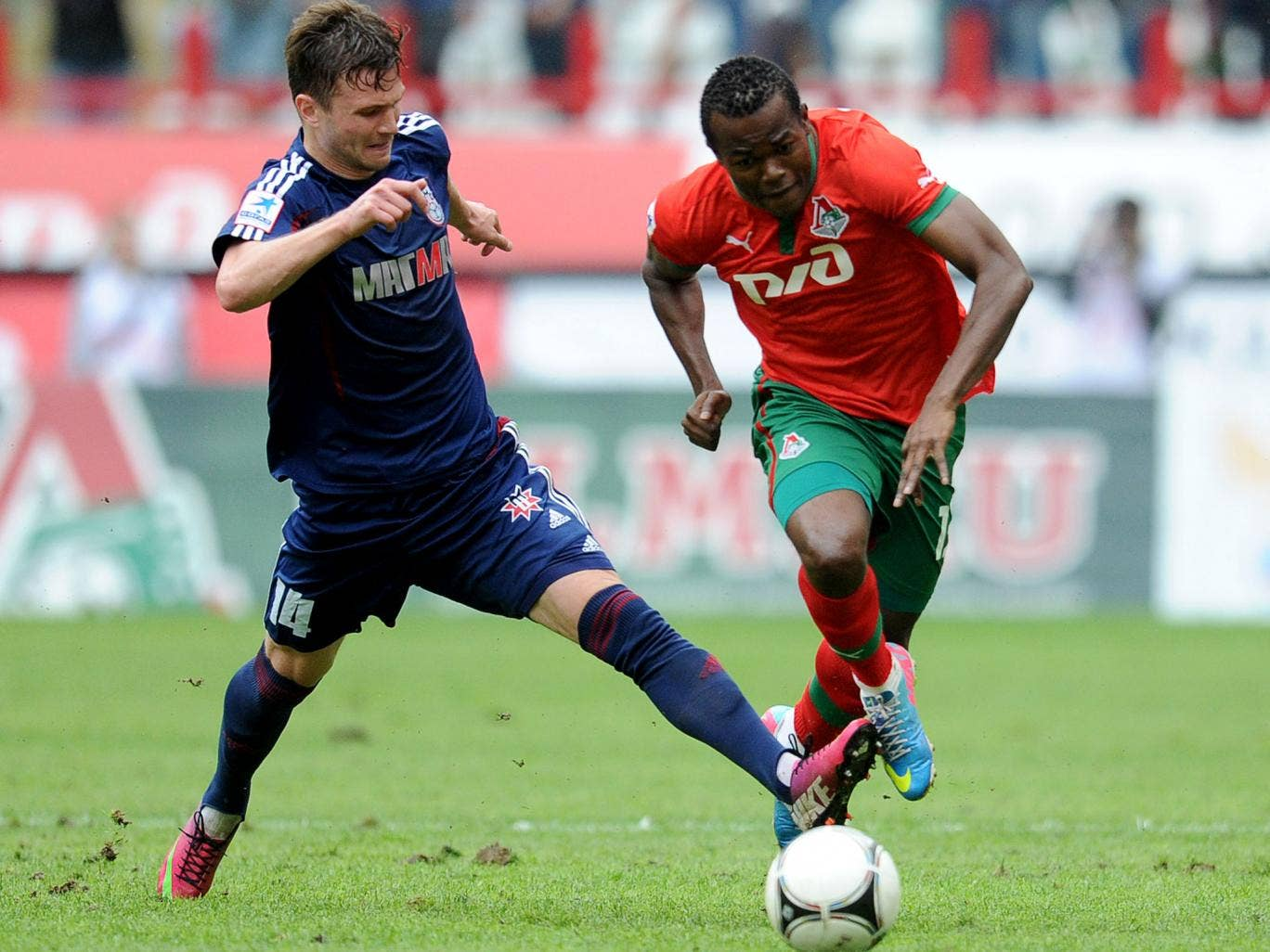 Victor Obinna (right) in action for Lokomotiv Moscow