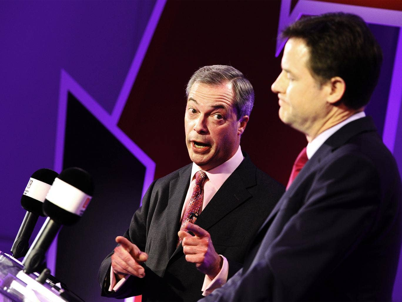 Nigel Farage and Nick Clegg take part in a debate over Britain's future in the European Union