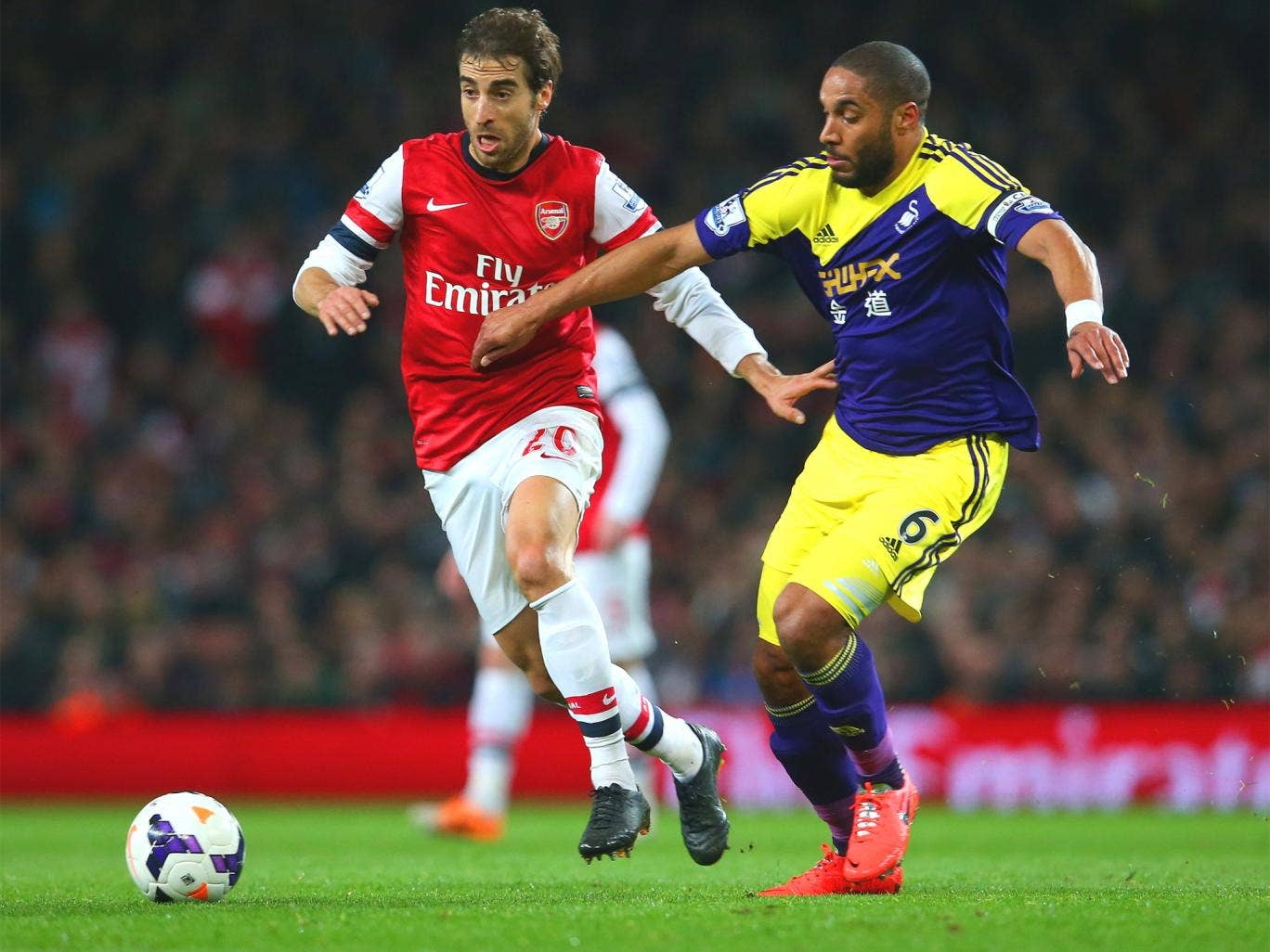 Mathieu Flamini (left) battles with Swansea's Ashley Williams on Tuesday