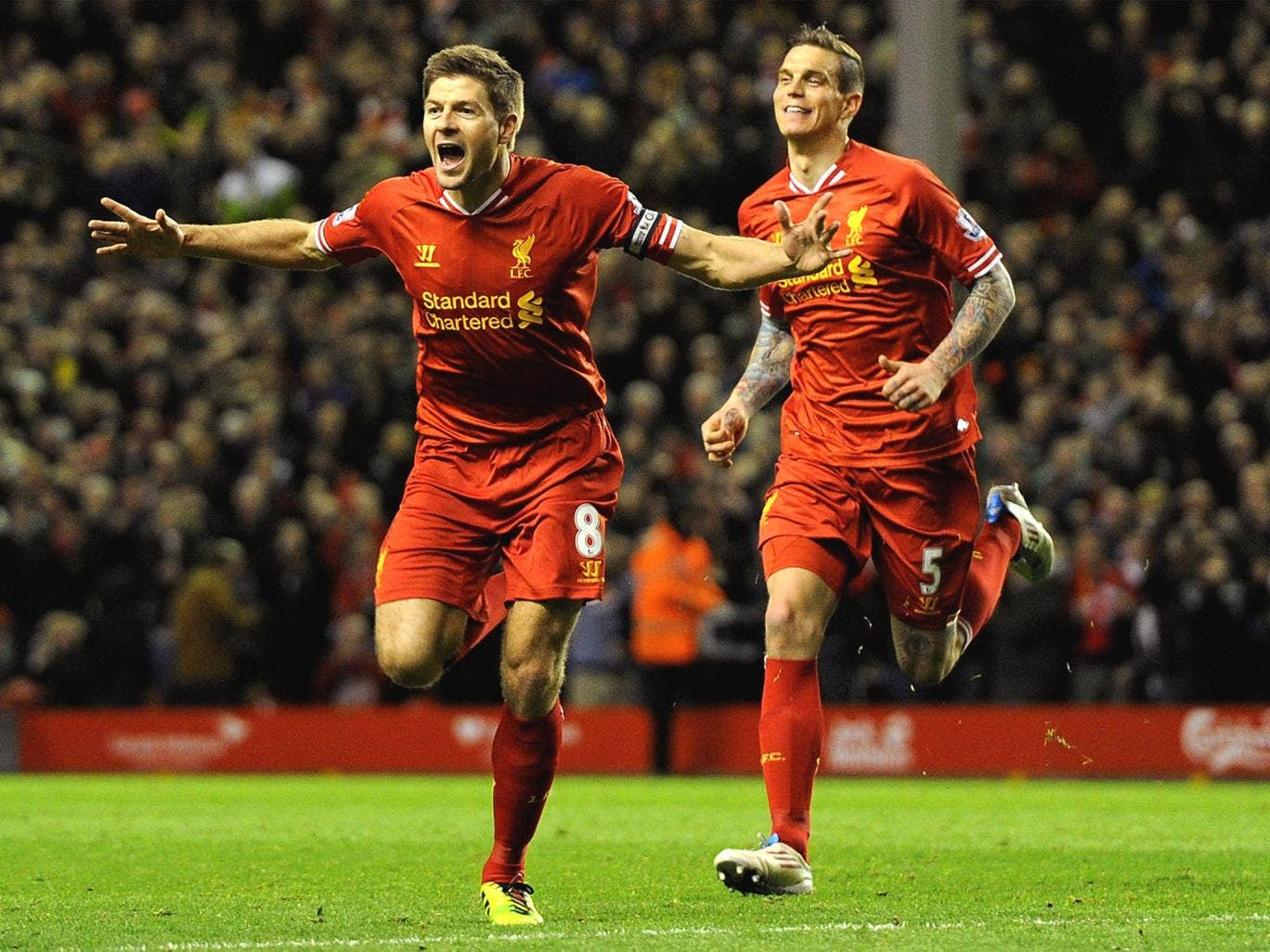 Steven Gerrard celebrates with Jordan Henderson after opening the scoring